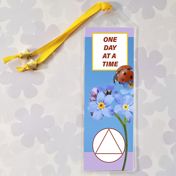 Bookmark with ladybug and the AA slogan: One day at a time