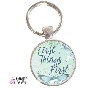 Keychain with AA Slogan First Things First on Butterfly Bliss background