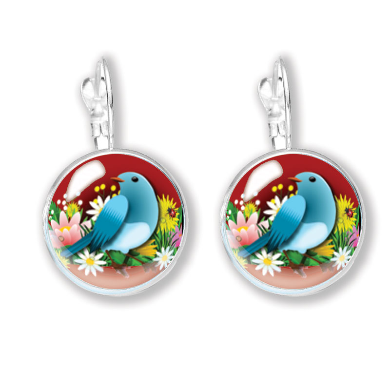 Glass cabochon earrings with blue bird on red