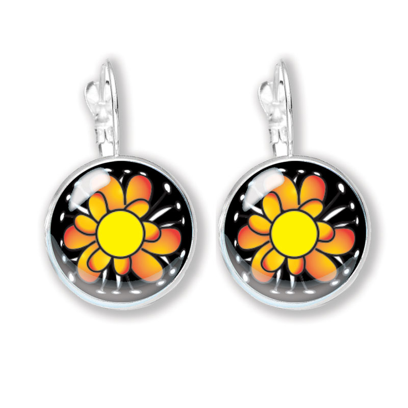Glass cabochon earrings with a fun yellow and orange flower on a black background