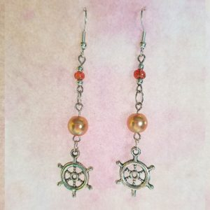 dangle earrings with orange beads and ship's wheel charms